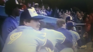 Stunned Blue Jays players including Rick Leach (9) look on as Tigers celebrate 1987 AL East title Oct. 4, 1987