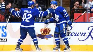 Mitch Marner (16), tied for the NHL rookie scoring lead, celebrates with Tyler Bozak